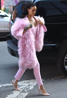 Rhianna in all pink including pink fur coat