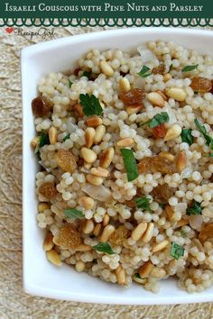 Israeli Couscous with Pine Nuts and Parsley by RecipeGirl.com ~ Beautiful, impressive side dish to serve guests! #dinner #sidedish #recipe