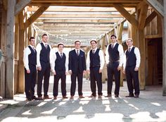 groomsmen in vests with the groom in a suit | Bamber Photography #wedding