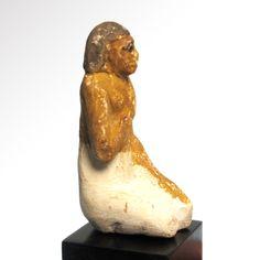 Painted Limestone Figure of a Kneeling Man, Old Kingdom, c. 2400-2200 B.C. Size:7.3 cm H - 2 7/8 inches - www.Artemission.com