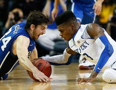 Nerlens Noel of the Kentucky Wildcats & Ryan Kelly of the Duke Blue Devils battle for a loose ball during the Champions Classic at the Georgia Dome. ~Kevin C. Cox, Getty Images
