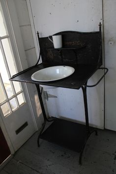 Fabulous metal washstand with graniteware bowl and cup...So many idea's come to mind! What would you do with this? $185.00