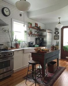 Farmhouse kitchen with rustic island.