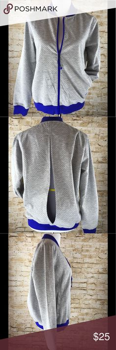"Grey & Purple Open Back Exercising Jacket Size M Super cute open back, light weight exercising jacket. In excellent condition, it doesn't have any stains or holes. Measurements: Collar to hem: 24"". Arm pit to arm pit: 21"". Adidas Tops Sweatshirts & Hoodies"