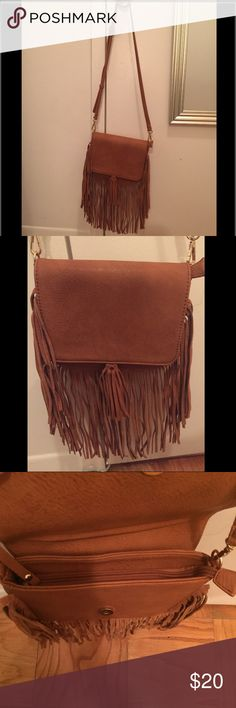 Brown fringe crossbody bag New bag never used . Gold detailing , fun suede fringe bag with adjustable shoulder strap, bag has metallic gold clasp and zipper that fully closes to protect belongings . Additional small pocket with zipper inside. Francesca's Collections Bags Crossbody Bags