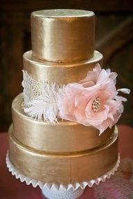 Metallic Gold Wedding Cake with large pale pink accent flower. Is this edible?