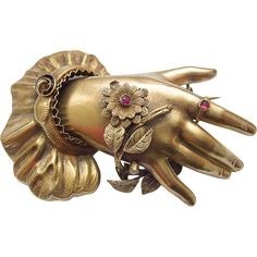 Gorgeous large rare Victorian 14 Karat Gold Hand Brooch c. 1850 Hand with a blossom branch and leaves, which is wrapped around the hand, panicle with