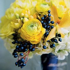 #SomethingBlue: Bold Sapphire Berry Bouquet | Sapphire berries add a shot of navy to this bridesmaid bouquet, and a navy blue ribbon ties the bundle together. | SouthernLiving.com