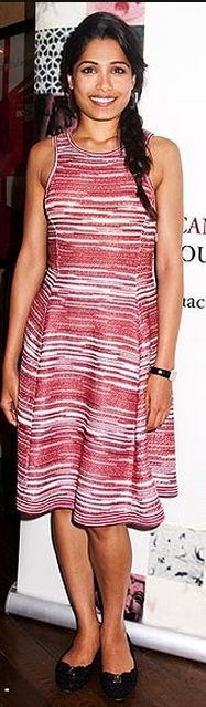 Who made Frieda Pinto's black ballet flat shoes and stripe pink dress that she wore in New York? Shoes – Salvatore Ferragamo  Dress – Missoni