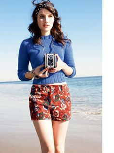 emma roberts in cute floral shorts and a blue sweater, lookin' pretty retro