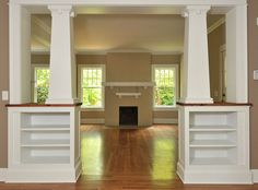 This is something I love about craftsman interiors. The use of the columns and half walls between rooms define separate spaces (and provide useful built-in bookcases), but do so in a way that doesn't block the light or make the house house feel chopped up too badly. Also, I love the mouldings in the room and the traditional windows.