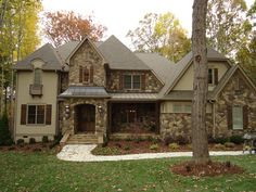 ARH Silver Oak Plan (Exterior 31) < Roof = Owens Corning Oakridge Driftwood >Metal Roof = Sentriclad Dark Bronze <Soffits/Fascia = SW7508 Tavern Taupe>  Siding = SW7548 Portico  <Stone = Coronado Split Fieldstone Bordeaux with Buff mortar > Shutters/Columns = SW3524 Chestnut Stain <Front Door = SW3524 Chestnut Stain>