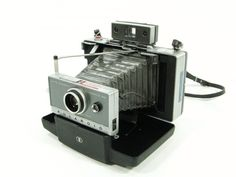 Vintage  Polaroid Land Camera model 100 - I have this camera! My sister bought it for me at an antiques store in Mississippi.