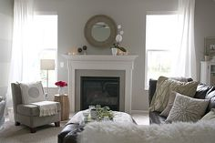 Like everything about this...gray walls, white trim, leather sofa
