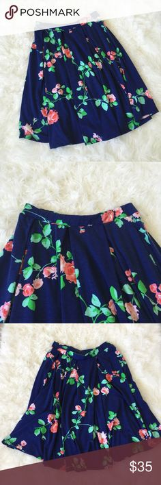 Lularoe Maddison Skirt Gorgeous navy blue Maddison skirt with green, pink, and red floral details. Full skirt with pockets. Super soft and has a stretchy waist. Always washed per LLR instructions and worn a handful of times. Does have some pilling but barely noticeable. The perfect spring skirt! LuLaRoe Skirts