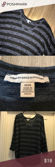 Navy and Black Striped AEO Top Navy and black oversized v-neck sweater top. 3/4 length sleeves. Super comfortable and soft. Never worn. Perfect condition. American Eagle Outfitters Sweaters V-Necks