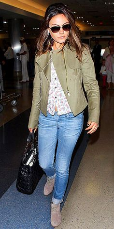 MILA KUNIS  Meanwhile, another star with a high-profile (rumored) honey plays the casually cute card at LAX, freshening up faded AG Adriano Goldschmied skinnies with a floral buttondown and a canvas Ann Taylor moto jacket.
