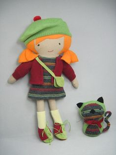 "Joni Doll & Kitty: What little girl wouldn't love these? Hand made of repurposed wool sweaters and wool fabrics. Doll is 19"" tall. $85."