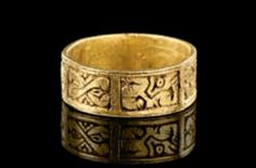 Golden ring with engraved animals and ornaments. Medieval, 12th - 13th century A.D. T