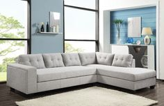 MODERN ALUMINUM GREY SECTIONAL.  This sleek 2 piece sectional features clean, straight arms, a tufted back and a comfortable grey fabric. Amazing value!!
