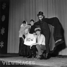 The Beatles performed their Christmas Show at the Astoria Cinema, Finsbury Park, London on New Years Eve, Dec 31, 1963. There was an adorable skit included in the show. John played the mustachioed villain, Paul the handsome hero, George the helpless heroine called Ermyntrude and Ringo threw snow!