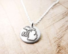 Tiny Michigan necklace, silver Michigan jewelry by lulubugjewelry on Etsy https://www.etsy.com/listing/158043624/tiny-michigan-necklace-silver-michigan