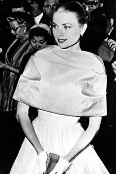 """I think it is important to see the person first and the clothes afterwards,"" Grace once said - but in her case, fashion became synonymous with self. Her impeccable, understated sense of style went hand-in-hand with her sophisticated persona; something that's clear to see from this graceful dress-stoal pairing at the 1956 Oscars."