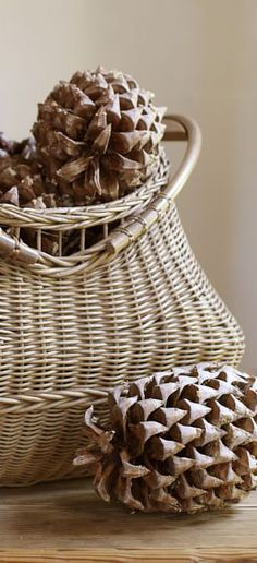 Rustic basket with pinecones