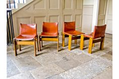 An original set of four Monk chairs designed by Tobia Scarpa in terracotta saddle leather and  walnut, 1974.  A beautiful and simple cutting edge design from a highly innovative designer, finished with great attention to detail and materials.