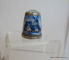 Silver thimble, probably Dutch or German cir 1930. Enamel design of windmills and pastoral scene all around.