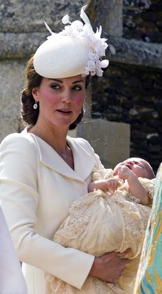 Catherine, Duchess of Cambridge, carries Princess Charlotte of Cambridge as they arrive at the Church of St Mary Magdalene on the Sandringham Estate for the Christening of Princess Charlotte of Cambridge on July 5, 2015 in King's Lynn, England.