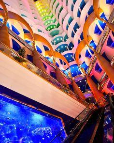The grand atrium of the 7-star hotel Burj Al Arab, Dubai, UAE. I wish life is as colorful as this. ☺   instagram: @queenetjuin   Around the world. Lonely Planet. Places to Go. Places to See. Travel and Leisure. Travel and Life. Travel and Living. Travel the World.  #burjalarab #jumeirah #mydubai #uae #unitedarabemirates #7star #luxury #luxuryhotel
