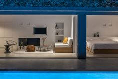 Photo 6 of 18 in A Modern Home Is Gently Slotted Into a Steep Slope in Santorini - Dwell Santorini Holidays, Free Standing Wall, Mountain Pictures, Interior And Exterior, Interior Design, Open Plan Living, Lounge Areas, Concrete Floors, One Bedroom