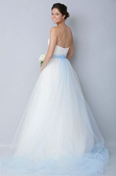 Incorporate your something blue into your dress, like this Theia gown,   with a colored sash and subtle blue tulle train.