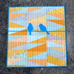 baby quilt birds blue orange