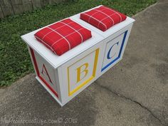 DIY toy box/bench seat made from repurposed cabinet doors!  So creative!!