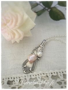 "Silver spoon necklace ""Morning Dew"", hand made from vintage silver spoon and sea pearl beads. www.varalusikka.fi"