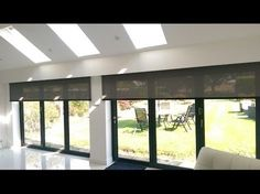Motorised electric roller blinds with Whisper screen fabric. The blinds are powered by Somfy Sonesse 40 RTS motors and the blinds are housed in a custom biult cavity. Brite Blinds in Sussex are suppliers of made to measure motorised blinds, curtains and awnings in Brighton, Hove…