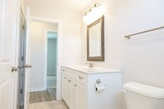 All white bathroom with drift wood mirror and tile floors. All White Bathroom, Beach Homes, Drift Wood, Wood Mirror, Floors, Tile Floor, Coastal, Furniture, Home Decor