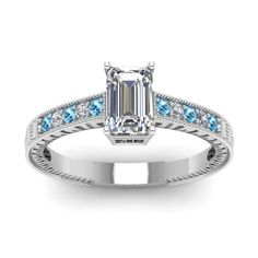 Brush Stroke Emerald Cut diamond Vintage Engagement Rings with Ice Blue Topaz in 14K White Gold exclusively styled by Fascinating Diamonds