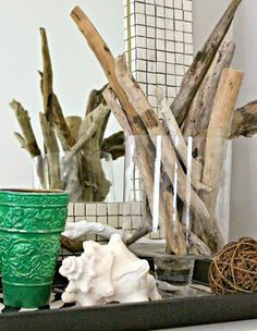 Driftwood in a Vase! Featured here:  http://www.completely-coastal.com/2015/05/southern-home-coastal-nautical-accents.html