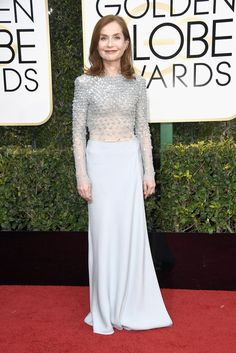 """Isabelle Huppert, won for best performance by an actress in a motion picture (drama) for her role in """"Elle,"""" wearing Armani Privé and Repossi, jewlery."""