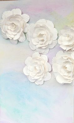 Watercolor Baby Shower Backdrop by PartiesforPennies.com Using paper plate flowers.