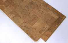 12mm Leather Luxury cork flooring plank.  A total of 6mm cork make up this plank.  A 3mm cork wear layer and a 3mm cork underlay.  Only the best producers use this combination.  Don't be fooled by low-end products.