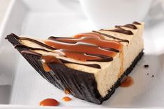 Coffee Cheesecake Pie...This scrumptious cheesecake, baked in a chocolate cookie crust, is flavored with coffee and drizzled with melted chocolate and a coffee-caramel sauce.