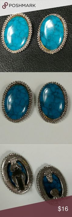 "Vintage clip on earrings signed Roma These clip on earrings are signed ""Roma"".  They feature a blue turquoise like stone (darker than most turquoise) set in a silver toned setting. Vintage Jewelry Earrings"