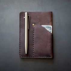 The handcrafted Urban Organizer Hybrid is a versatile do-it-all that can carry most folding knives flashlights and pens along with your passport and a Field Notes sized notebook.