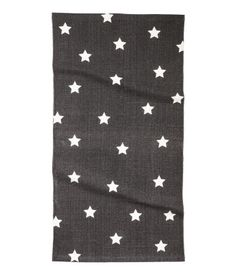 Charcoal gray. Cotton rug with a printed star pattern.
