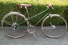 Vintage Motobecane Mixte restored by Ride Bicycles in Ravenna-Seattle,Wa. Bici Couture bag, Velo Orange fenders and rack, cork handles, Brooks saddle. Super hot masculine bike! Hot!