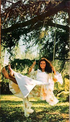 Sophia Loren grinning on a rope swig in Dior